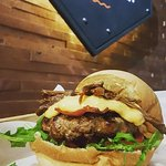 Grill House Signature Burger, 200g beef patty topped with bacon, melted cheddar and brisket.