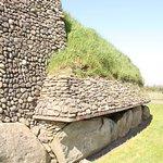 Stone facing at rear of mound