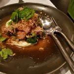 Grilled Pork Shoulder accompanied by specialty sauce