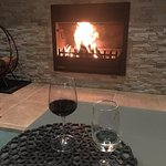 Open wood fire in guest lounge room. Drinks & snacks available for purchase.