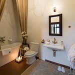 Classical baroque-style rooms and suites with  a private bathroom with a bath or shower