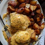 Complex, delicious eggs benedict dish, with a healthy portion of excellent home fries