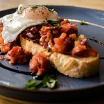Plum Tomato Bruschetta with poached egg