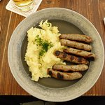 Plate of Six Nürnberger Sausages with Warm Potato Salad