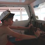 my son driving the boat good fun