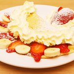 Home made crepes with fresh fruits and cream.