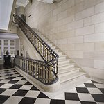 The second floor of the Museum features large halls, a gilded grand staircase, and marble floors