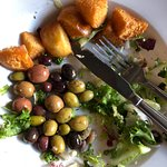 26 salty olives, and greasy lumps of fried brioche