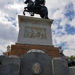 Great fountain and statue along Calle De Bailén