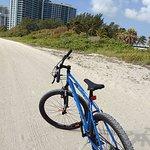 Bike along the beach on the hard sand path