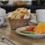 Breakfast with fruits, bread, tea, coffe and more.