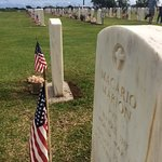 The grave of Magario Marion is surrounded by many of the fallen.