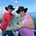 mom and daughter catching triggerfish and having fun