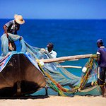 Fishermen hauling their nets in fornt of our gotel... Add culture to your beach stop