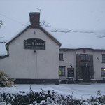 You can't tell but there's a brand new thatched roof under all that snow!