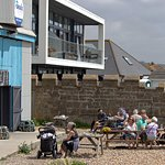 Seating directly on the beach at Griggs fishmongers and cafe