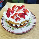 victoria sponge, fresh cream, strawberries and jam