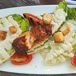 Caesar salad with blackened salmon