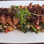 Duck breast over couscous