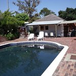 Solar heated swimming pool with dark blue finish to retain heat.