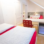 Triple room with shared bathroom. With a refrigerator and a safe.