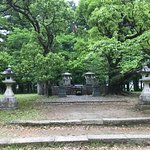 Markers and camphor trees on the site of the original Taisha