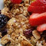 Organic yogurt, granola and fresh fruit.