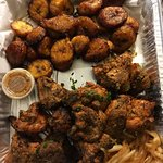 Dibi Chicken with a side of fried plantains- spicy!