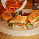 Beautifully presented sandwich with sweet potato fries
