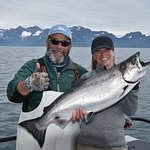 Typical King Salmon and typical stoked fisherwomen and Captain Andy