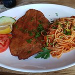 Veal Milanese. Dry, Chewy and served with steaming Spaghetti!