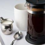 Organic coffee served in a fresh press pot.