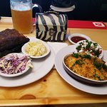Rack of ribs and potato salad and mac and cheese and coleslaw
