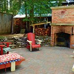 Back patio with a BBQ and fire pit. A great place to spend time during  summer