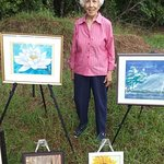 Dot Richardson with some of her watercolor paintings