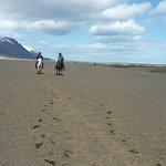 riding over black sand
