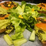 Wholegrain bread with smoked salmon, pea paste, pumpkin seeds and dill