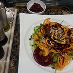 Spaghetti from carrots, beetroot and cucumbers, red beans, lettuce, orange and goji berries