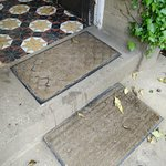 Threadbare mats and stained step