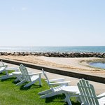 Enjoy a cocktail steps from the ocean in one of our adirondack chairs