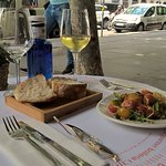Chilled white wine with summer salad at Calle Serano...