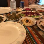 Hummus, rice wrapped in grape leaves, a chutney of sorts etc.