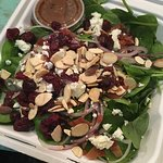 Spinach Salad w/ dried cranberries, toasted almonds, red onion, feta cheese, and citrus vinaigre