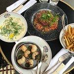 Cheese ravioli, beef tartare, escargot
