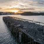 Dilapidated wharf looking towards oil storage facility at Greenwich.