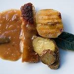 Crispy suckling pig spit, roasted caramelised apple and lemon thyme kipflers