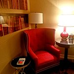 A reading chair with a book is in each room and the book is by the author named on the door!
