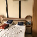 Family Room - Queen Bed and cupboard