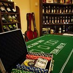 We rent various table and card games in the wine bar for free. Come and play with your Texas Hol