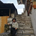 At the entrance stair of KURJE LHAKHANG MONASTERY